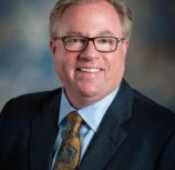 Dr. Chris Domes, Board Member